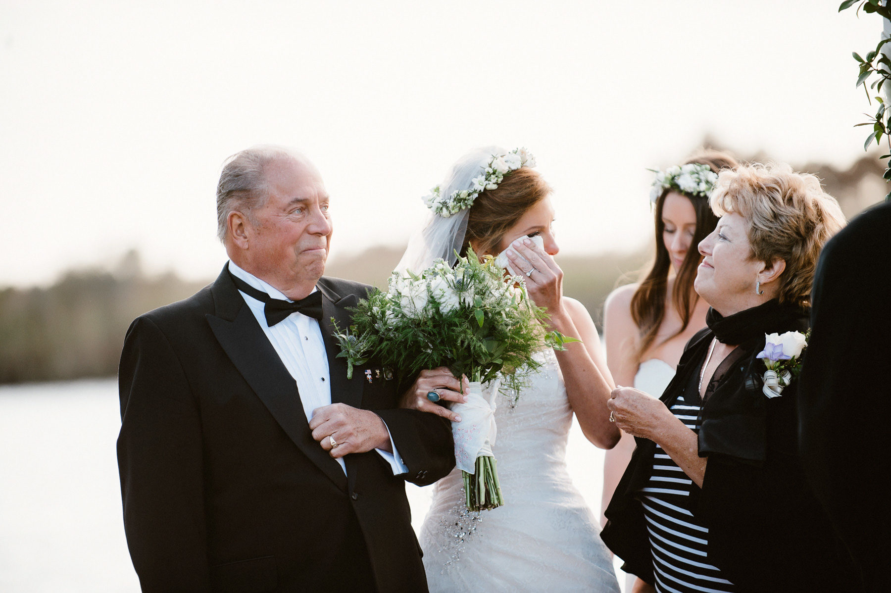 emotional wedding moment with bride and her parents