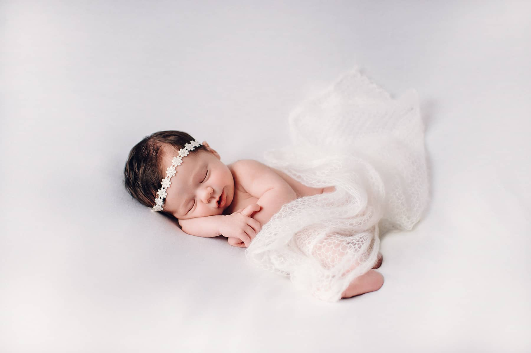 newborn girl on white
